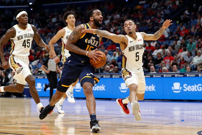 Former Colorado State basketball player Stanton Kidd, shown driving on New Orleans' Josh Gray during a preseason game Oct. 11, 2019, earned a spot on the Utah Jazz's regular-season roster.