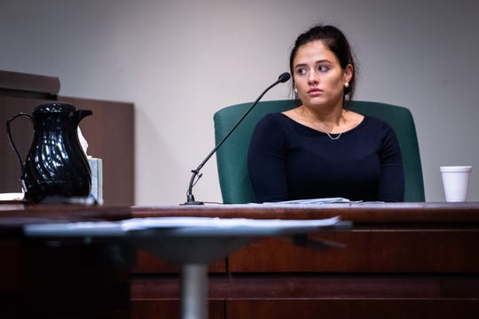 Savanah Nabors, former assistant to suspended Greenville County Sheriff Will Lewis who has accused him of rape during a trip to Charlotte, NC, looks to Lewis and his wife Amy while testifying  during day two of Lewis' trial, Tuesday, October 22, 2019.