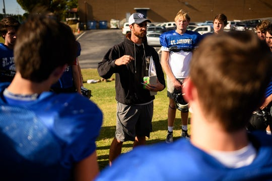 St. Joseph Catholic School head coach Jon Wheeler speaks with his players during practice Tuesday, Oct. 22, 2019.