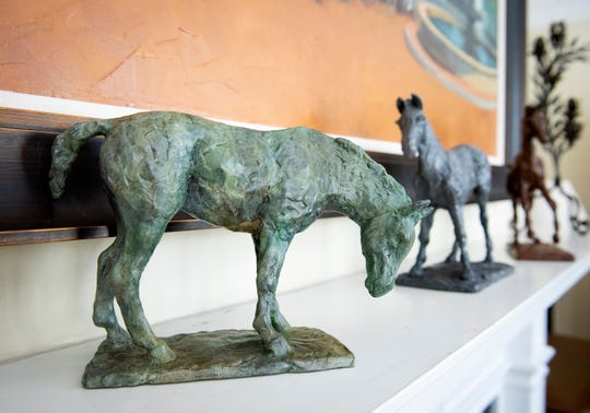 Small horse sculptures by Ann Malphrus