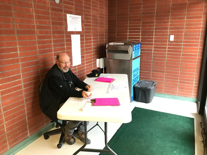 Brad Clark of the Cascade County Treasurer's Office monitors a drop-off ballot box at the Courthouse Annex. Employees are staffing the box this year to make sure residents dropping off ballots on behalf of others have filled out a new ballot delivery registry form that's required for the first time this city election. Residents dropping off their own ballot don't need to fill out the pink form, which was mailed with ballots to residents.