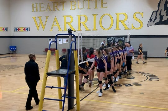 The Valier Panthers shake hands with the Heart Butte Warriors after defeating them in three sets. The Monday night game had previously been delayed twice due to severe weather and a video that stirred controversy between the two communities.