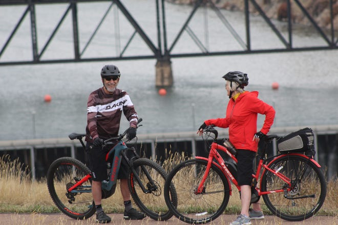 Kern and Bev Lee pause during a recent e-bike ride along Great Falls' Southside Trail system.