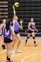 Laressa Halladay of the Trident Women's Volleyball Club hits a roll-off spike against Breakthrough in Trident Women's Volleyball League action Oct 17 at UOG. Also shown are teammates  Ria Dimag, No. 13 and Justine Yeban, No. 9.
