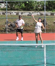 The husband-wife team of Carl and Millie Leon Guerrero captured the mixed doubles crown at the ASC Family Classic Tennis Tournament.