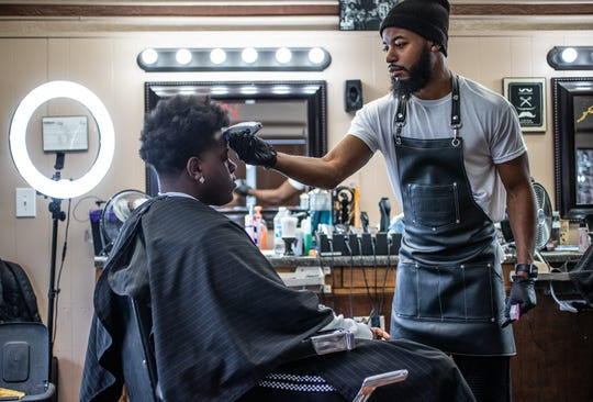 11:33 a.m. — Inside Kenny's Barber Shop, located on East 38th Street, barber Marvell Barnes trims the hair of Hamilton Southeastern student Savion Wilkerson on Wednesday, Oct. 16, 2019. Wilkerson is the nephew of former Indiana University basketball player and Indiana Basketball Hall of Fame member Bobby Wilkerson, who played for Indiana's 32-0, 1976 National Championship team. Wilkerson would go on the play in the NBA for Chicago, Cleveland, Denver and Seattle.
