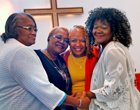 Maxine Bryant, 60, second from right, stands with her sisters at Scott United Methodist Church, Sunday, Oct. 13, 2019.  Adopted as a child, she was reunited with her siblings after 60 years. Her sisters are Donzella Triplett, 69, from left, Birdie Peoples Ferguson, and Victoria Peoples, 67, right.