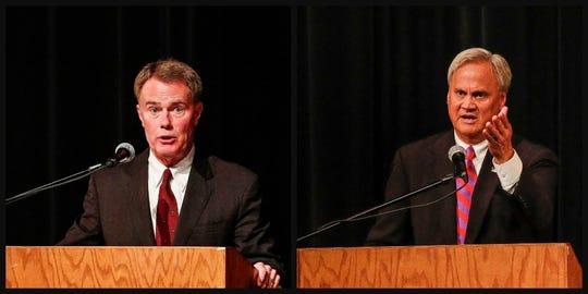Indianapolis Mayor Joe Hogsett (left) and state Sen. Jim Merritt (right) during a mayoral debate at Arsenal Technical School, Monday, Oct. 21, 2019, Indianapolis.
