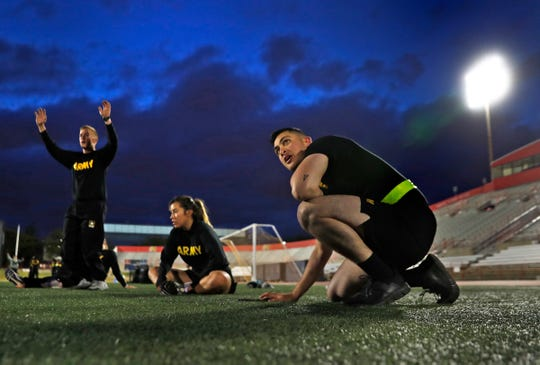 7:30 a.m. — Army ROTC cadets at IUPUI pause during an early morning workout at the Michael A. Carroll Track and Soccer Stadium on the IUPUI campus, Wednesday, Oct. 16, 2019.