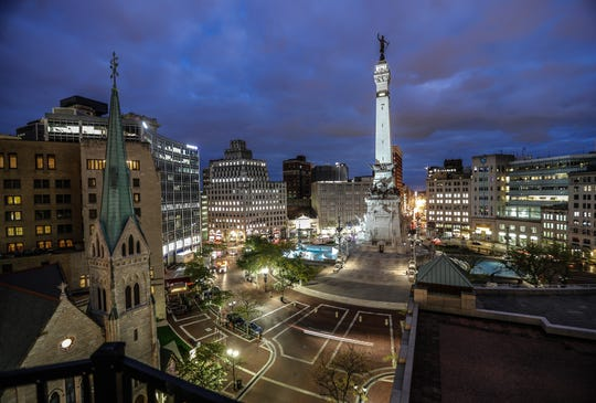 7:33 p.m. — The sun sets on Monument Circle, as seen from the roof of the Sheraton Indianapolis City Center Hotel on Wednesday, Oct. 16, 2019.
