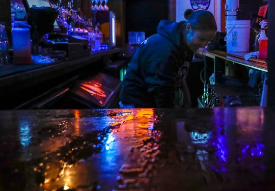 11:55 p.m. — Bartender Becca Miller cleans glasses behind the bar at the Slippery Noodle in Indianapolis on Wednesday, Oct. 16, 2019.