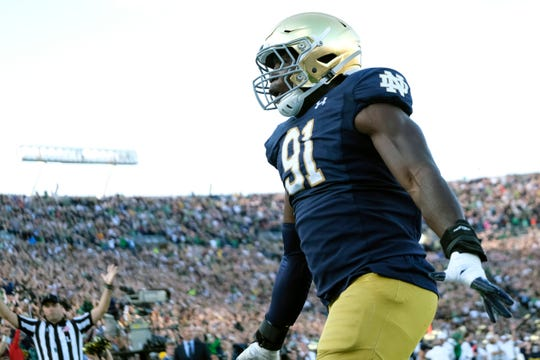 Notre Dame defensive lineman Adetokunbo Ogundeji (91) reacts after scoring a touch down on a fumble recovery while playing Virginia in the second half of an NCAA college football game in South Bend, Ind., Saturday, Sept. 28, 2019. Notre Dame won 35-20.