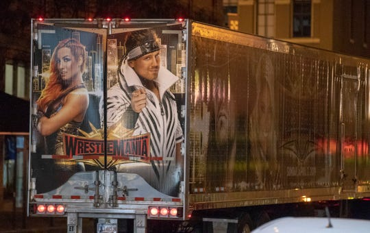 4:41 a.m. — A WrestleMania truck drives through Downtown Indianapolis on Thursday, Oct. 17, 2019, in advance of a weekend show at Bankers Life Fieldhouse.