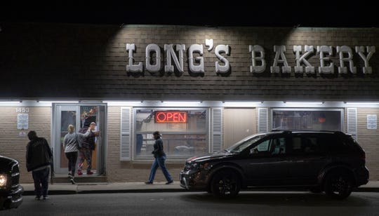 5:30 a.m. — The first customers of the day line up at the door at Long's Bakery on Thursday, Oct. 17, 2019.