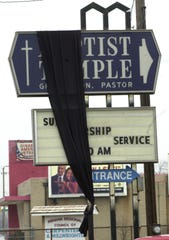 Put in place by church members, a black shroud representing the death of religious liberty is draped over a sign for the Indianapolis Baptist Temple on Madison Avenue after federal marshals seized the church on Feb. 13, 2001.