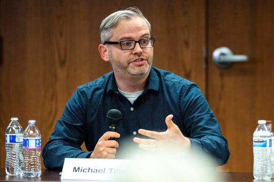 Michael Tilley speaks during a school board candidate forum co-hosted by the Iowa City Education Association and the Iowa City Press-Citizen, Monday, Oct., 21, 2019, at the Public Library in Coralville, Iowa.