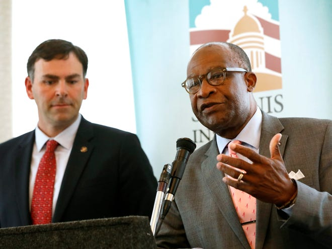 Republican Sen. Michael Watson of Pascagoula, left, listens as Democratic former Hattiesburg Mayor Johnny DuPree, responds to a question at a forum sponsored by Mississippi State University's Stennis Institute of Government and the Capitol Press Corps, Monday, Oct. 21, 2019, in Jackson, Miss. Both men are candidates for secretary of state.