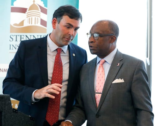 Republican Sen. Michael Watson of Pascagoula, left, and Democratic former Hattiesburg Mayor Johnny DuPree, both candidates for secretary of state, confer following a forum sponsored by Mississippi State University's Stennis Institute of Government and the Capitol Press Corps, Monday, Oct. 21, 2019, in Jackson, Miss.