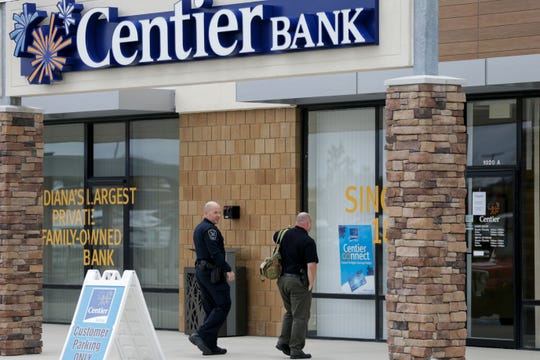 Police investigate a bank robbery at Centier Bank, 1020 Sagamore Parkway West, Tuesday, Oct. 22, 2019 in West Lafayette.