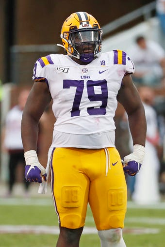 LSU center Lloyd Cushenberry III (79) readies for a play against Mississippi State during the first half of their NCAA college football game in Starkville, Miss., Saturday, Oct. 19, 2019. LSU won 36-13. (AP Photo/Rogelio V. Solis)