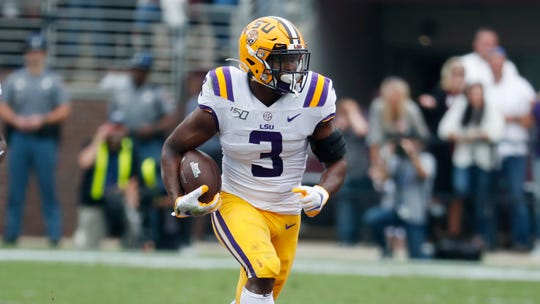 LSU running back Tyrion Davis-Price (3) runs for a short yardage gain against Mississippi State during the first half of their NCAA college football game in Starkville, Miss., Saturday, Oct. 19, 2019. LSU won 36-13. (AP Photo/Rogelio V. Solis)