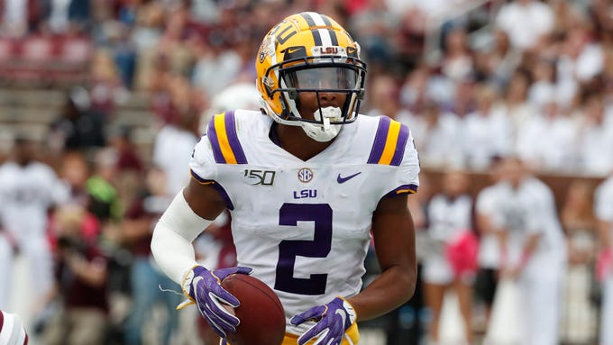 LSU wide receiver Justin Jefferson (2) runs towards the sidelines after a short pass reception against Mississippi State during the first half of their NCAA college football game in Starkville, Miss., Saturday, Oct. 19, 2019. LSU won 36-13. (AP Photo/Rogelio V. Solis)