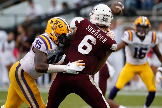 LSU linebacker Michael Divinity Jr. (45) pressures Mississippi State quarterback Garrett Shrader (6) into rushing a pass during the second half of their NCAA college football game in Starkville, Miss., Saturday, Oct. 19, 2019. LSU won 36-13. (AP Photo/Rogelio V. Solis)