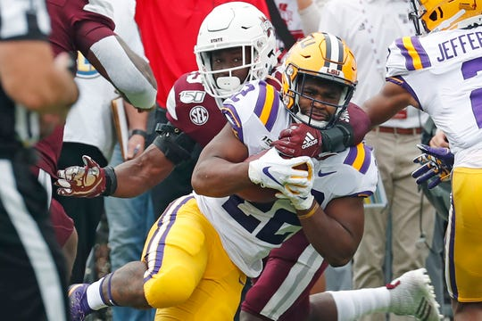LSU running back Clyde Edwards-Helaire (22) is tackled by Mississippi State defender during the first half of their NCAA college football game in Starkville, Miss., Saturday, Oct. 19, 2019. LSU won 36-13. (AP Photo/Rogelio V. Solis)