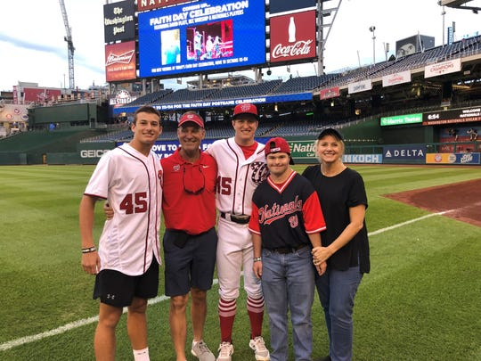 Andrew Stevenson (center) stands with his parents Will and Stephanie Stevenson and two of his three brothers after a game. Stevenson is a member of the Washington Nationals.