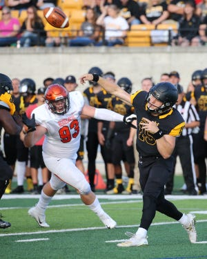 Jack Wurzer of Pinckney set the Adrian College single-game passing record last Saturday with 403 yards in a 34-31 victory over Alma College.