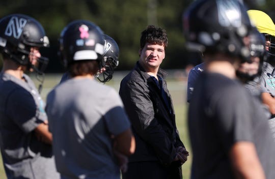 William Smith, center, one of the team managers for the North Oldham High School football team, stood on the sideline with players during practice at the school in Goshen.