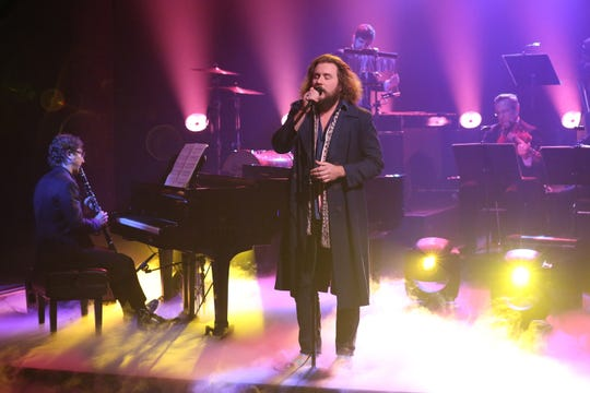"Jim James (center) performs with Teddy Abrams (left) and members of The Louisville Orchestra on ""The Tonight Show Starring Jimmy Fallon"" on Oct. 21."