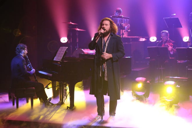 """Jim James (center) performs with Teddy Abrams (left) and members of The Louisville Orchestra on """"The Tonight Show Starring Jimmy Fallon"""" on Oct. 21."""