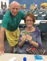 JCMI's Monday Night Bingo winner Freddie Biebman of Marco with Bernie Seidman.