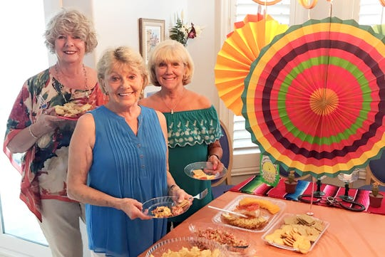 Cindy McQuarrie, Connie D'Errico and Betsy Zinner are ready to create a taco.