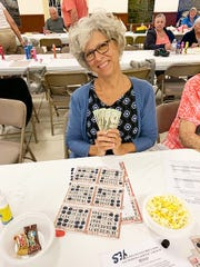 Knights of Columbus San Marco Council #6344 held their first Bingo night charity fundraiser of season on Oct. 17. Above, big jackpot winner Liz Whalen from New Jersey.