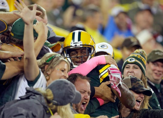Green Bay Packers wide receiver Davante Adams (17) celebrates his touchdown during the Green Bay Packers-Minnesota Vikings NFL football game at Lambeau Field in Green Bay, Wisconsin, Thursday, October 2, 2014.