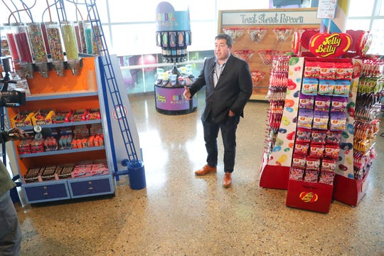 Milwaukee Bucks and Fiserv Forum President Peter Feigin explains the new Candy Lab candy store on the upper concourse at Fiserv Forum.