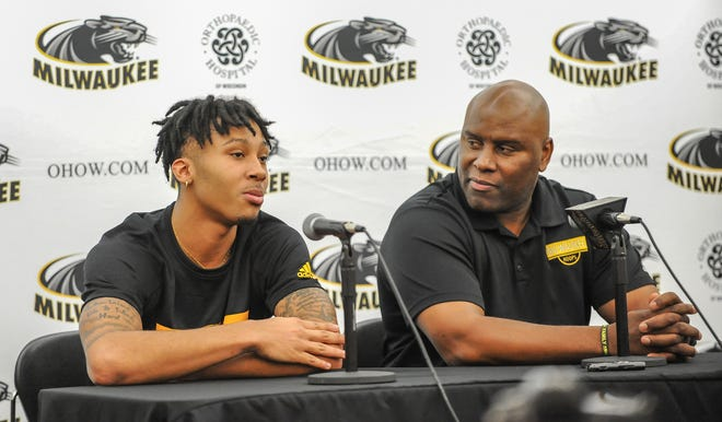 Transfer guard Te'Jon Lucas discusses his expectations for his first season at UW-Milwaukee while UWM head coach Pat Baldwin listens Tuesday, October 22, 2019, at The Pavilion on campus.