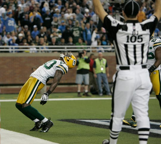 Donald Driver exults after catching a 7-yard pass for a touchdown in the 3rd quarter against the Detroit Lions at Ford Field , Thursday, November 26, 2009.