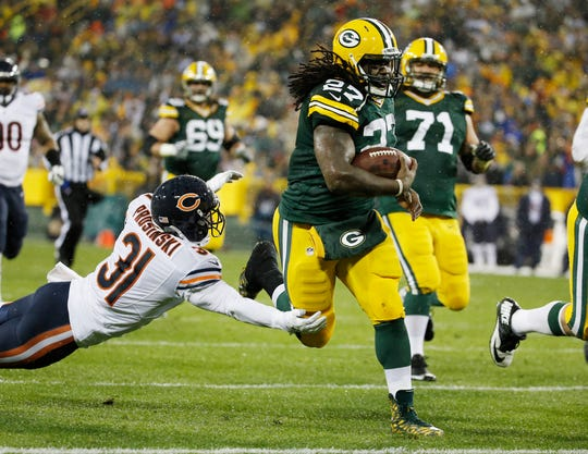 Eddie Lacy runs for a touchdown during the first half of an NFL football game against the Chicago Bears, in Green Bay, Wis.