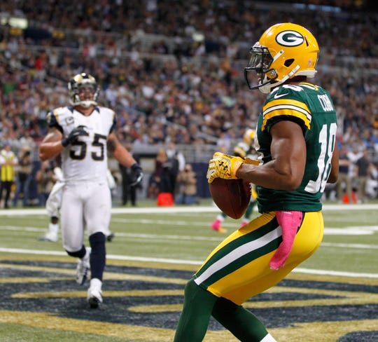 Green Bay Packers Randall Cobb dances into the end zone after receiving a touchdown pass from Aaron Rodgers in the second half   during the NFL game between the Green Bay Packers and St. Louis Rams, Sunday,  October 21, 2012. at Edward Jones Dome in St. Louis Missouri.