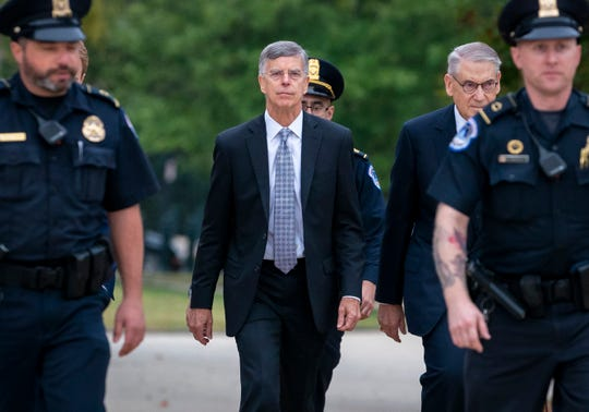 Ambassador William Taylor is escorted by U.S. Capitol Police as he arrives Tuesday to testify before House committees as part of the Democrats' impeachment investigation of President Donald Trump at the Capitol in Washington.