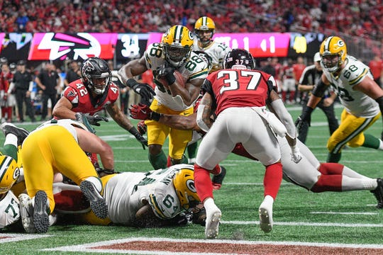 Green Bay Packers running back Ty Montgomery (88) scores a touchdown against the Atlanta Falcons during the second half at Mercedes-Benz Stadium.