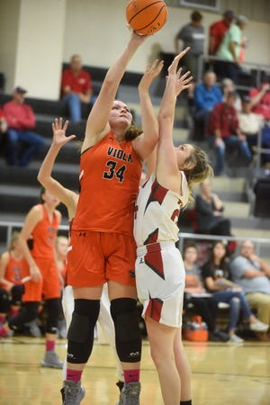Viola's Braidlyn Fierce puts up a shot during the Lady Longhorns' 63-53 victory over Pangburn on Monday night.