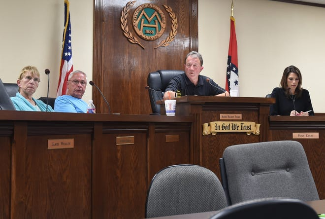 Mountain Home Mayor Hillrey Adams (second from right) talks about the city's 2020 budget as council members (from left) Jennifer Baker, Wayne Almond and Paige Dillard Evans listen on Thursday, Oct. 17. The City Council will hold a special meeting Monday night to discuss the city's health insurance plan.