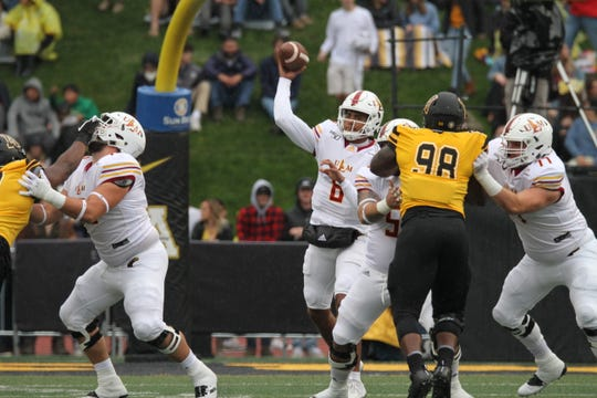 Caleb Evans (8) became the third quarterback in ULM history to surpass 8,000 career passing yards doing a 52-7 loss at Arkansas State on Saturday at Kidd Brewer Stadium in Boone, North Carolina.