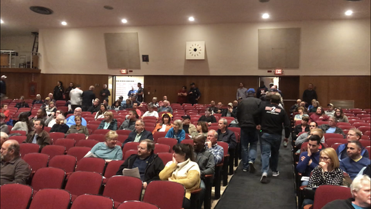 Boonton first responders who came out for a board of alderman meeting, rush out when their emergency pagers sounded and the town fire siren went off, calling them to an emergency. The board later voted to transfer dispatch to the county 911 system during the heated meeting at Boonton High School. Oct. 22, 2019.