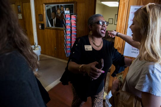 Tour Director Wanda Battle greets guests with a hug at Dexter Avenue King Memorial Baptist Church in Montgomery, Ala., on Tuesday, Oct. 22, 2019.