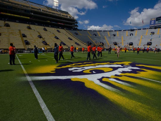 Auburn players walk on the field at Tiger Stadium before a game against LSU on Oct. 14, 2017, in Baton Rouge, LA.
